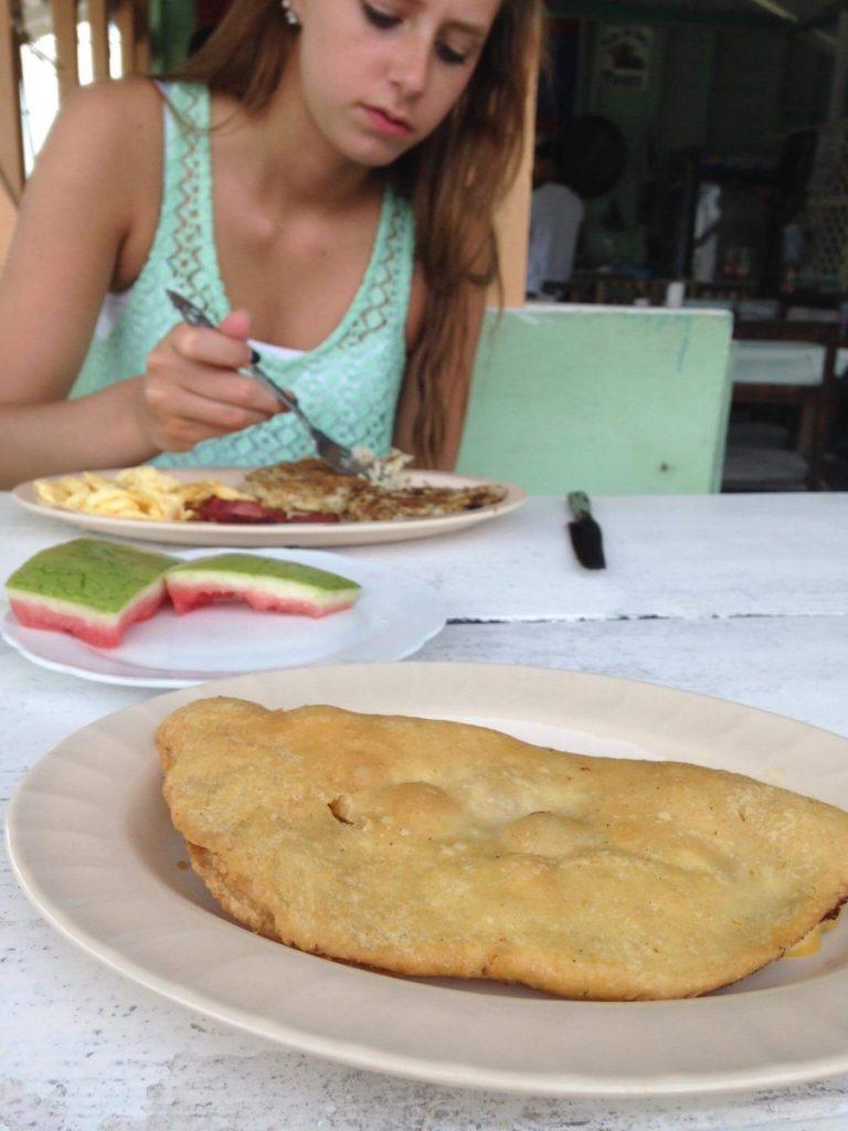 Emily eating breakfast in Belize