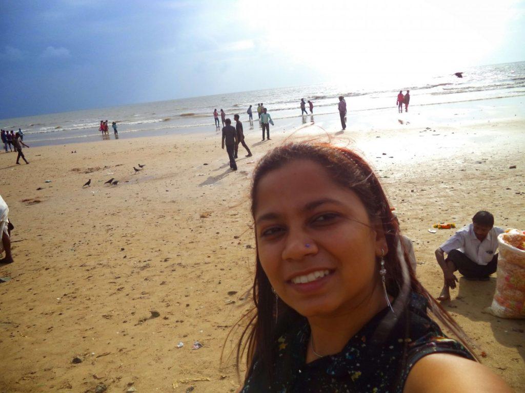 bhavi taking a selfie on the beach