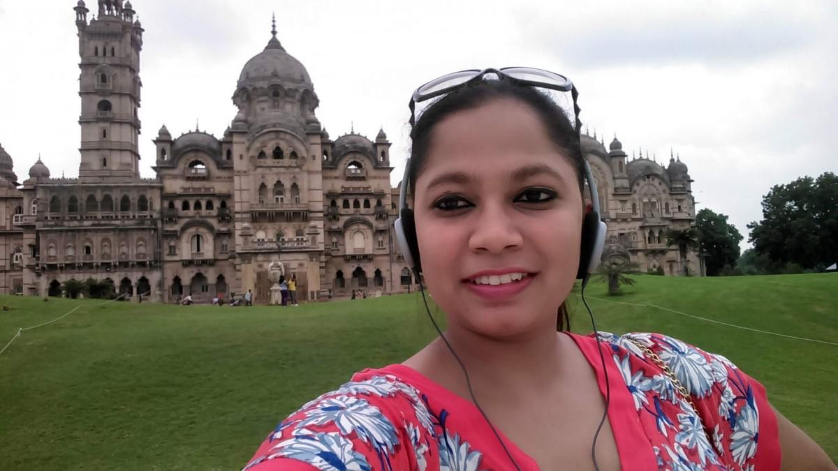 Bhavi posing in her headphones
