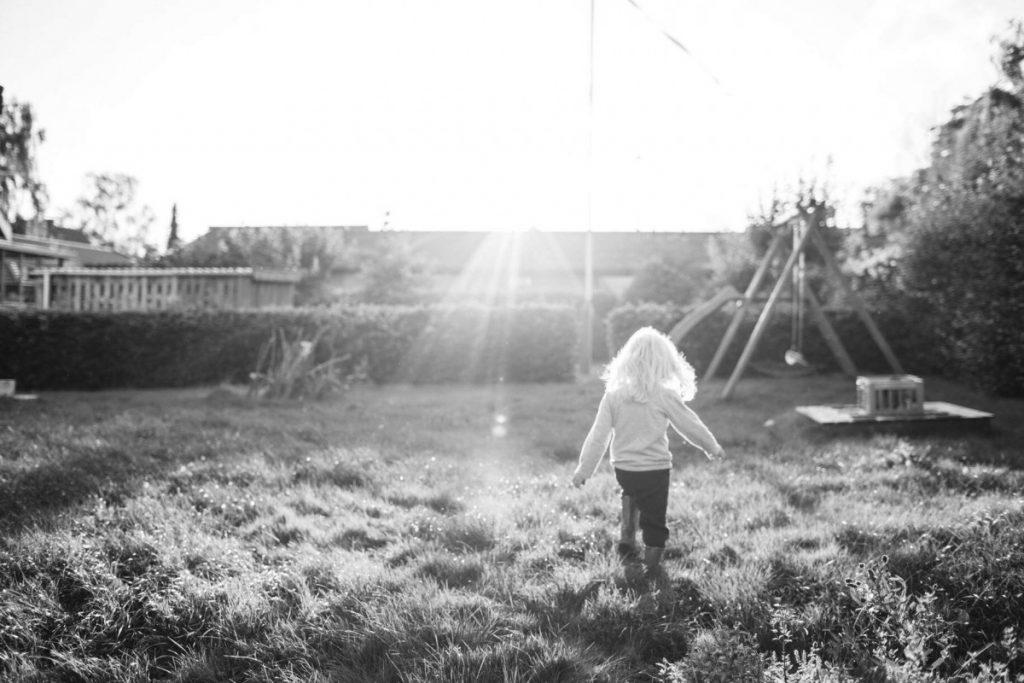 Kelly's daughter running in the sunlight
