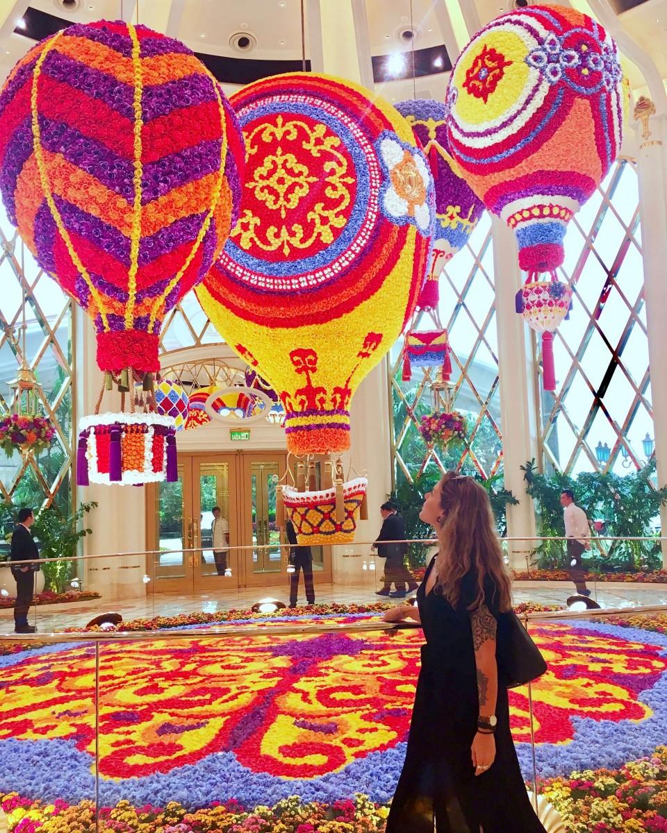 alyssa walking through colorful flower displays