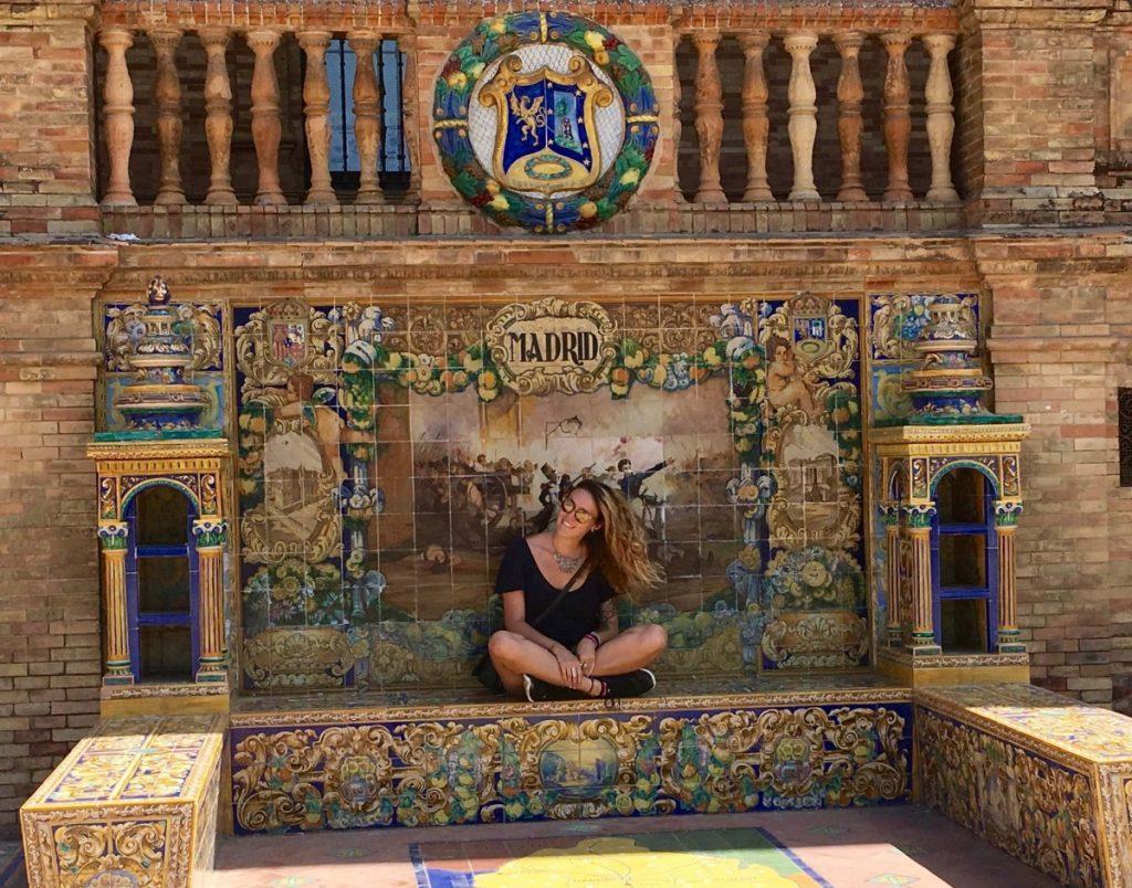Alyssa posing by a tiled wall in Madrid