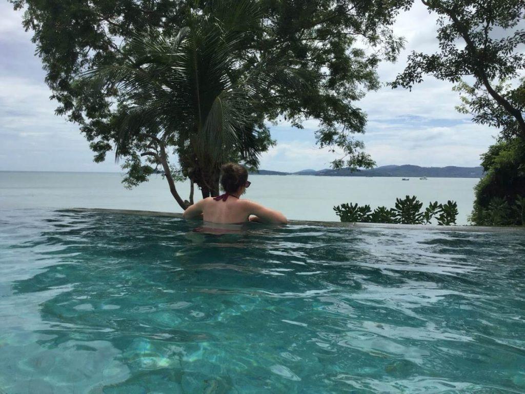 Sarah swimming in an infinity pool.