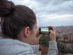 Sarah taking a photo in Barcelona
