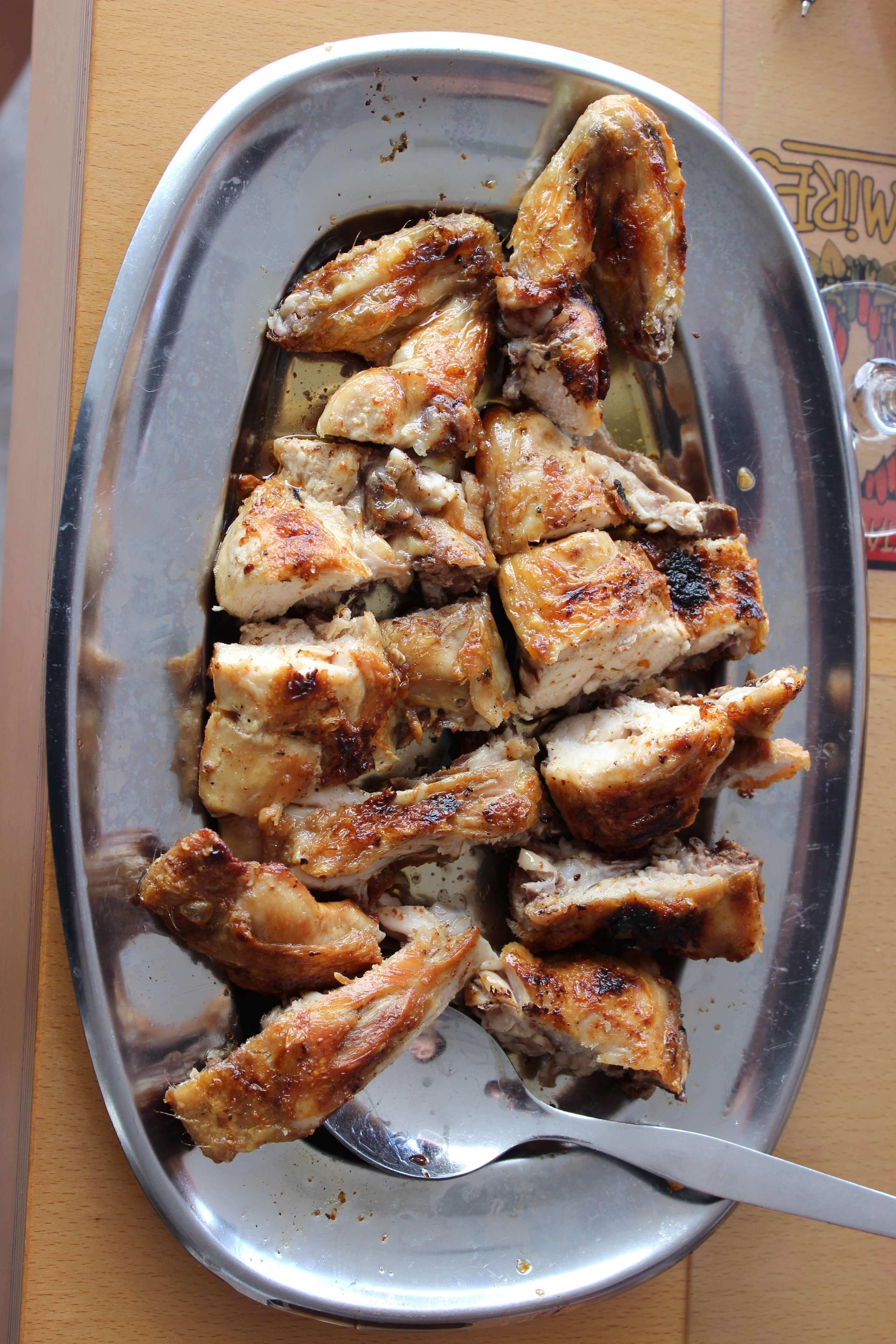 piri piri chicken on a silver platter from a small Azorean restaurant