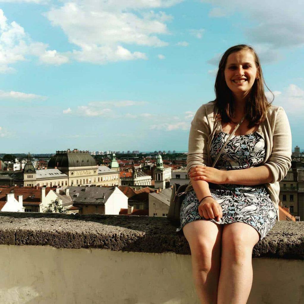 Gabby sitting on a wall.