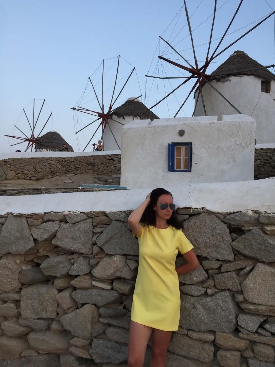 Natalia posing by windmills in Greece