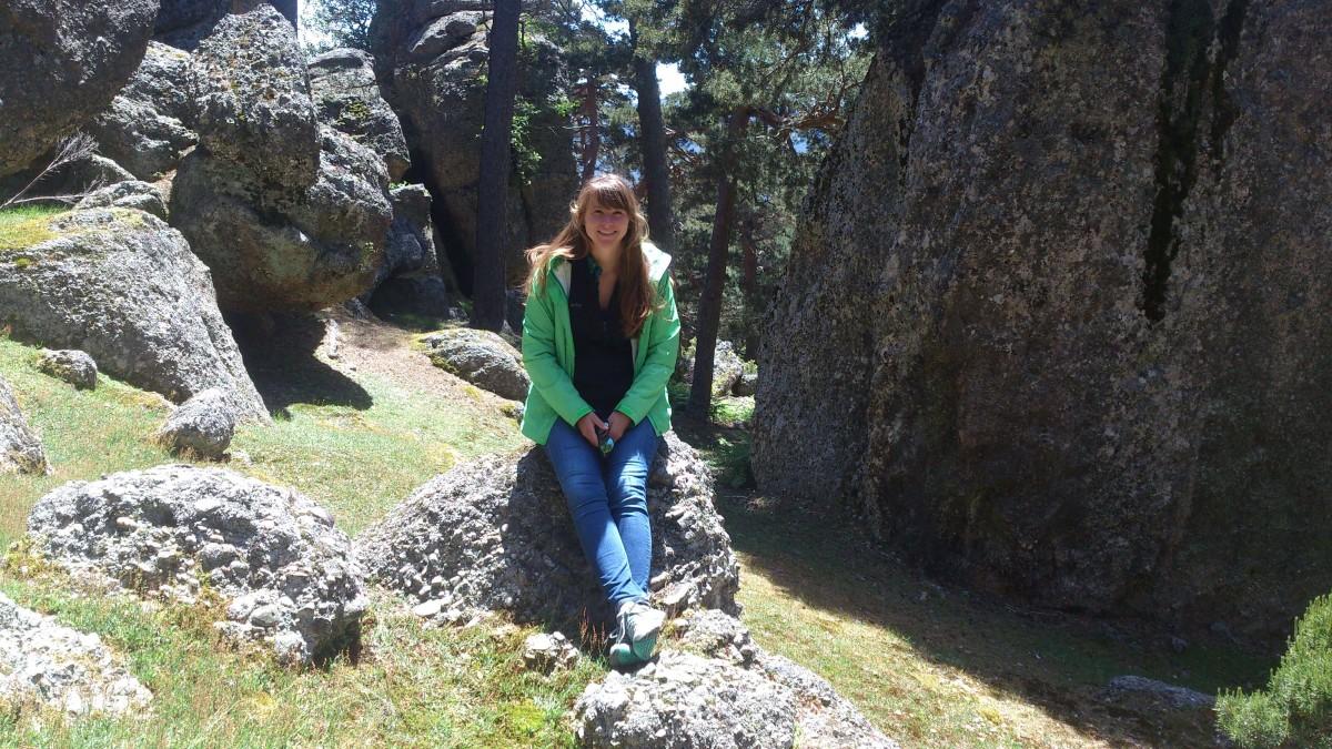 Angela hiking on the rocks