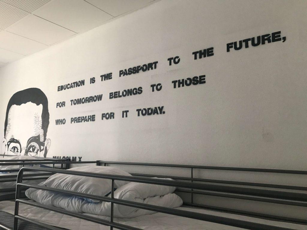 globalhagen hostel bunk bed under a malcolm x quote