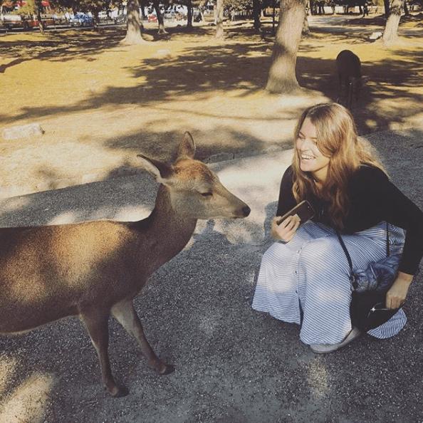 Jess posing next to a deer in Nara, Japan.