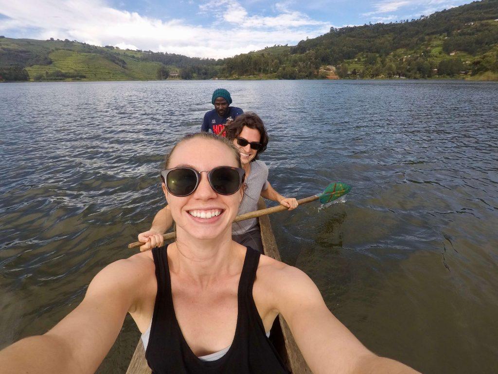 Riding in a dugout canoe to Om Hostel Bunyoni on Lake Bunyoni.